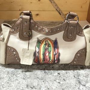 Handbags - P&G purse. Faux leather. Tan w/ Mary on front NWT